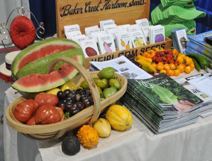 Baker Creek Heirloom Seed Co. exhibit booth with produce from our garden.